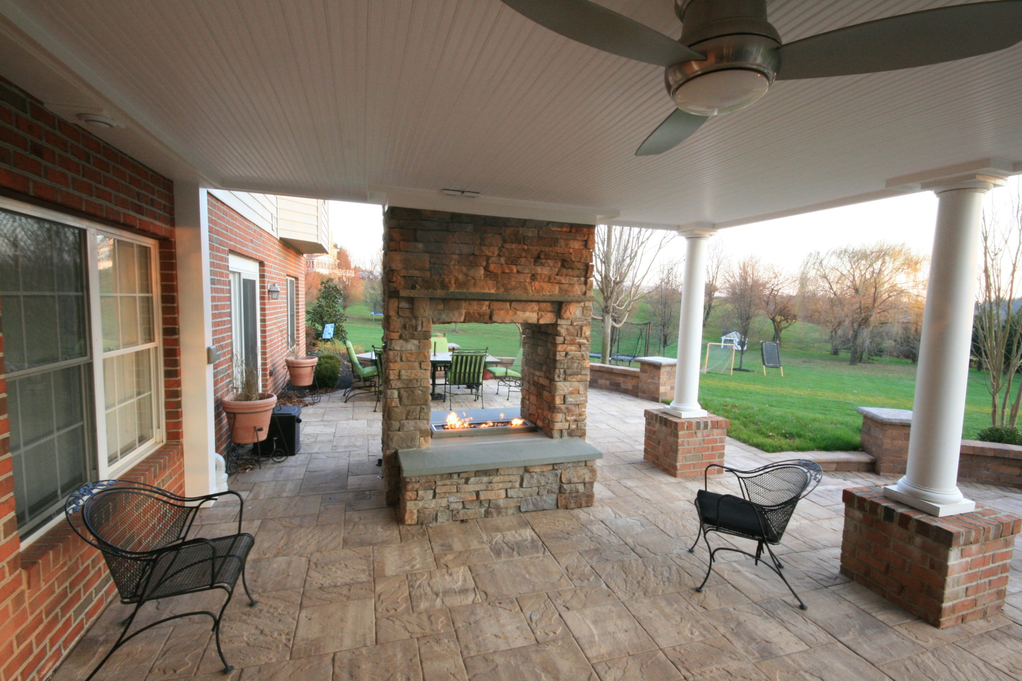 Patio Under deck with fireplace, finished under deck